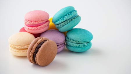 Macaroons on white background with space