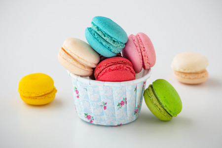 Macaroon in baking paper cup on white background Stock Photo