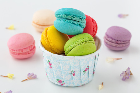 Macaroons with flower on white background