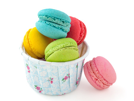 Macaroons in baking paper cup isolated on white background