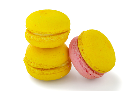 Yellow macaroon isolated on white background