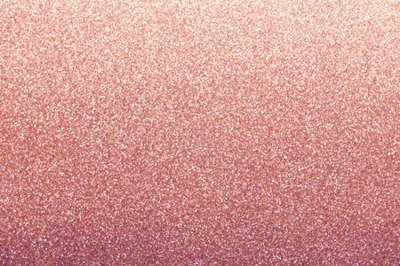 Roségold Glitter Hintergrund, glänzendes Geschenkpapier defokussiert