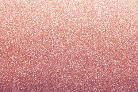Rose gold glitter background, shiny wrapping paper defocused