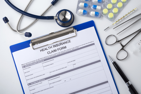 Health insurance form with pen on doctor desk, top view Stock Photo