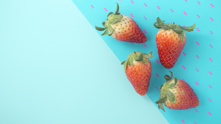 Strawberry on blue background with space, top view Stock Photo