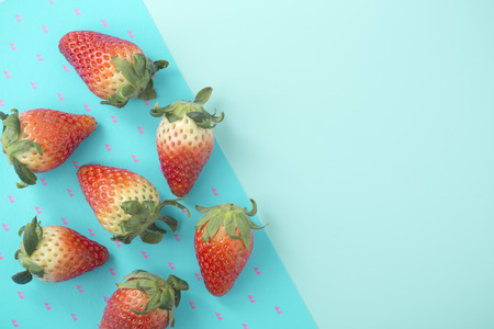 Strawberry on two tone blue background with space, top view
