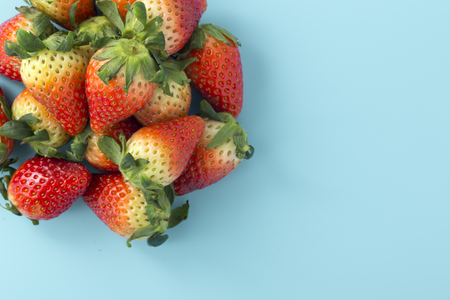 Strawberries on light blue background with space, flat lay Stock Photo