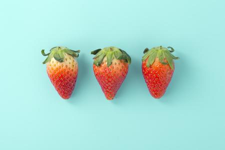 Strawberries on light blue background, flat lay Stock Photo