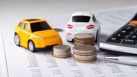 Coins, cars with calculator on financial statement, buying, trading, leasing