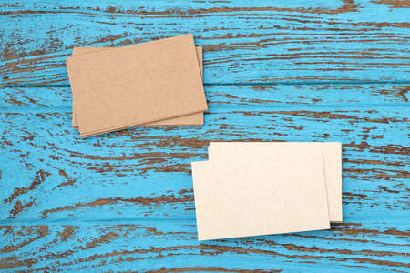 Business card mockup on blue wooden table, top view