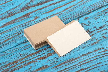 Kraft business card mockup on blue wooden table