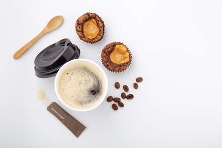 Black coffee with brownie and sugar on yellow background, coffee time, top view Standard-Bild