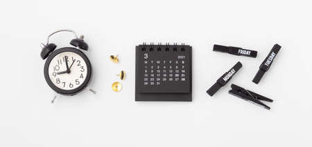 Calendar with clock on white background, top view, business schedule, event concept Standard-Bild
