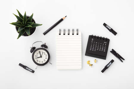 Notebook with calendar and alarm clock on white background, business schedule, event concept