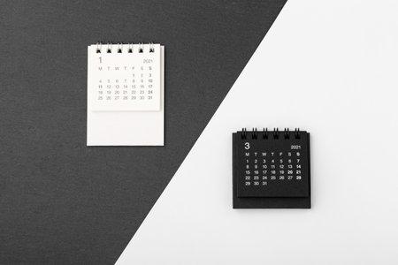 Calendar 2021 on black and white background, top view Standard-Bild