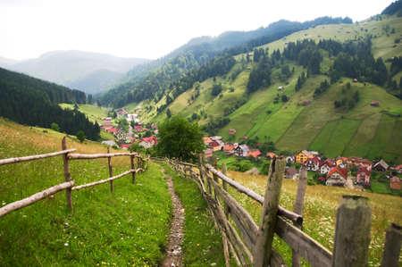 Rural road to village between the hills