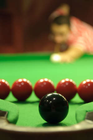 Close-up of snooker black ball next to a pocket, but surrounded by several red balls (making the shot impossible) Stock Photo - 6282681