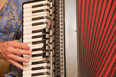 virtuoso: Man playing on the accordion Stock Photo