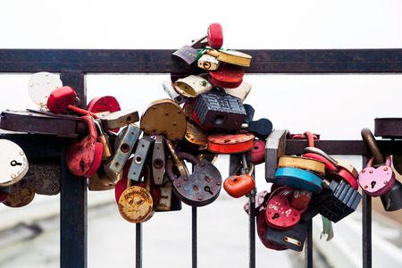 Traditions for lovers. Locks for eternal love. Metal bridge with locks