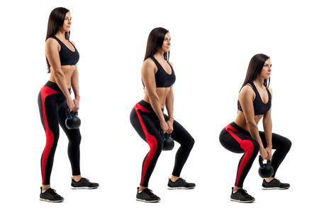 Exercise of squat with weight performed by a sports woman in three positions on a white isolated background. Side view Фото со стока
