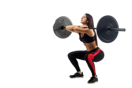 Young athletic brunette woman doing squat with a barbell, loki in front of him, position full sucker on white isolated background