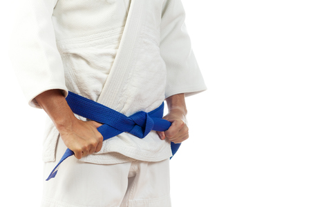 Close-up of a man martial artist in a white suit for judo, Jiu Jitsu with a blue belt Stock Photo