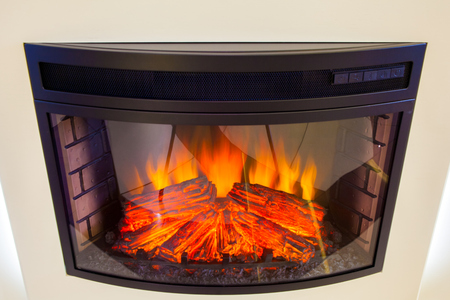 Close-up White electric fireplace with fire