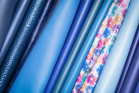 A close-up of multi-colored natural leather: blue and different blue backgrounds. Pattern made of genuine leather Banco de Imagens