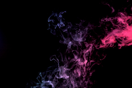 Dense multicolored smoke of purple and pink on a black isolated background. Background of smoke vape