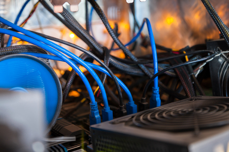 Close-up equipment for mining crypto-bitcoin, ether. Video cards, motherboards, blue lights