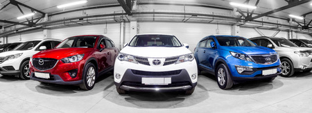 Novosibirsk, Russia - February 12, 2017:  in the car showroom are rows of city crossovers for sale: Mitsubishi, KIA, Mazda, Toyota and others Editoriali