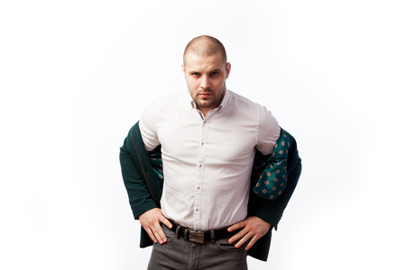 Bald man businessman in an unbuttoned white shirt, green suit tiredly looking and posing on white isolated background