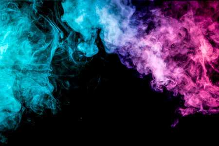 Colorful smoke of  pink and blue on a black isolated background. Background from the smoke of vape
