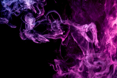 Pink and purple cloud of smoke of  black isolated background. Background from the smoke of vape Banco de Imagens - 98085539