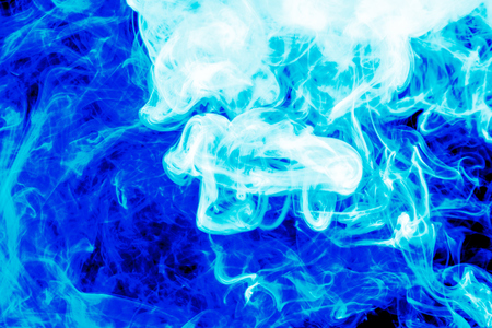 Cloud of  blue smoke on a black isolated background. Background from the smoke of vape Stock fotó