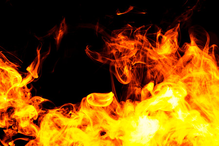 Thick fiary smoke on a black isolated background. Fire flames background.