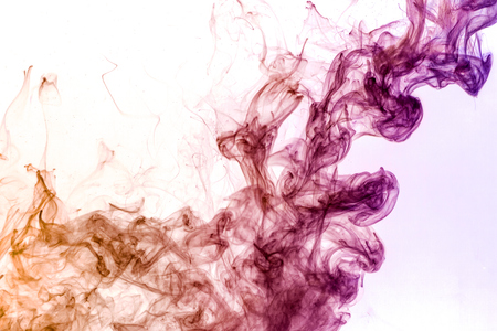 Thick colorful  pink and orange smoke on a white isolated background. Background from the smoke of vape Stock Photo