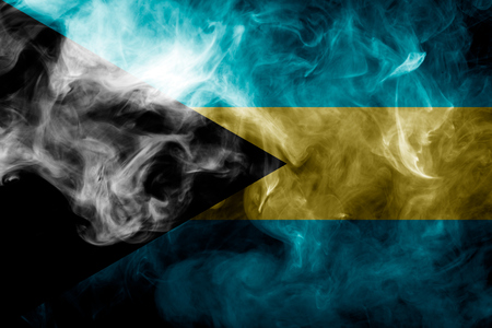 National flag of Bahamas from thick colored smoke on a black isolated background Stock Photo