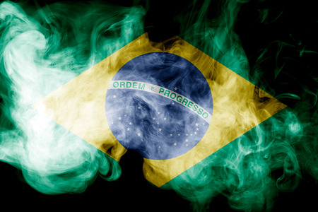 National flag of Brazil from thick colored smoke on a black isolated background