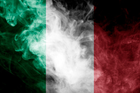 National flag of Italy from thick colored smoke on a black isolated background