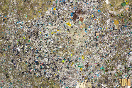 Aerial top view photo from flying drone of large garbage pile. Garbage pile in trash dump or landfill. Environmental pollution