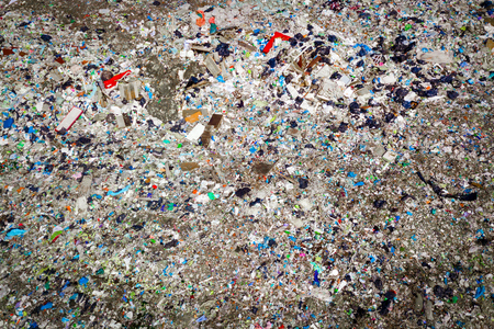 Environmental pollution. Aerial top view photo from flying drone of large garbage pile. Garbage pile in trash dump or landfill.  Stock Photo