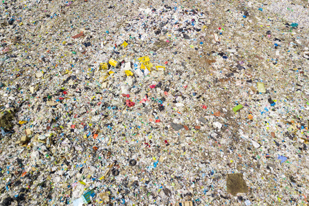 Helicopter drone shot. Aerial photography is a modern urban dump. Landfill with a lot of debris polluting the ecological environment of the city Stock Photo