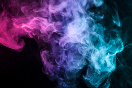 Pink, blue and red cloud of smoke of  black isolated background. Background from the smoke of vape Stock Photo
