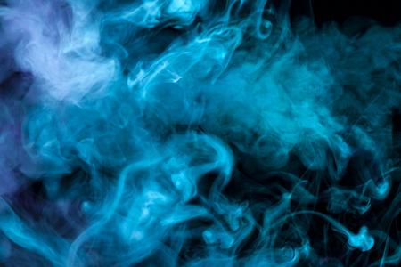 blue smoke  on a black isolated background. Background from the smoke of vape  Stock Photo