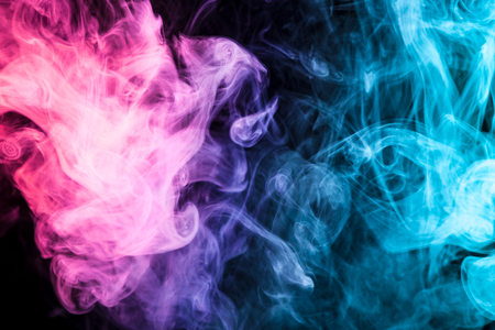 Pink and blue smoke on black background