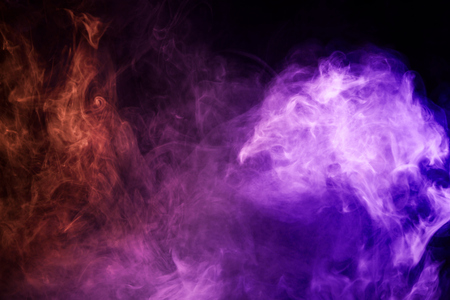 Colorful pink and blue smoke  on a black isolated background. Background from the smoke of vape