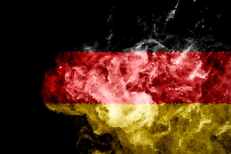 National flag of Germany from thick colored smoke on a black isolated background