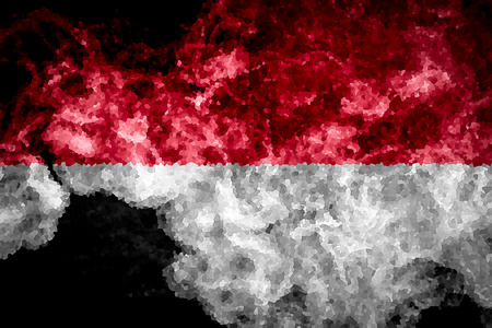 National flag of Indonesia from thick colored smoke on a black isolated background
