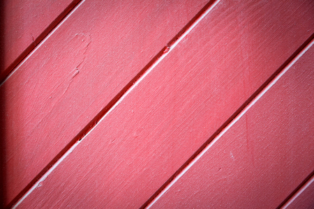 Close-up of a red wooden floor from the lining, wooden background